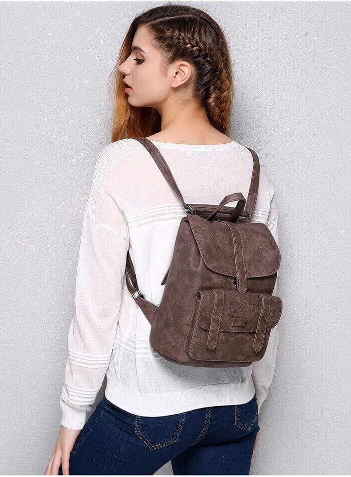 girl with grey backpack at back