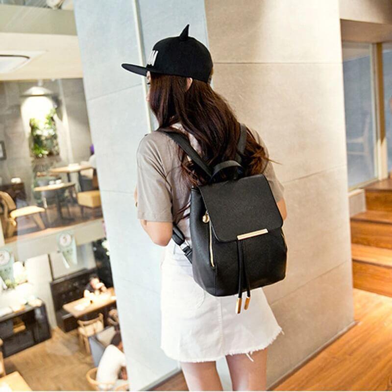 Women showing black backpack